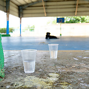 JULY 21, 2018---ARECIBO, PUERTO RICO---<br /> A stray dog sits in the middle of a basketball court in Arecibo. <br /> (Photo by Angel Valentin/Freelance)