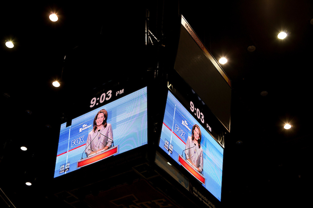 Republican presidential hopeful Michele Bachmann is seen on an overhead screen in the Hilton Coliseum during the Republican presidential debate on Thursday, August 11, 2011 in Ames, IA.