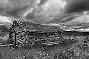 Landscape photographs of old log cabin in Boundary, AK