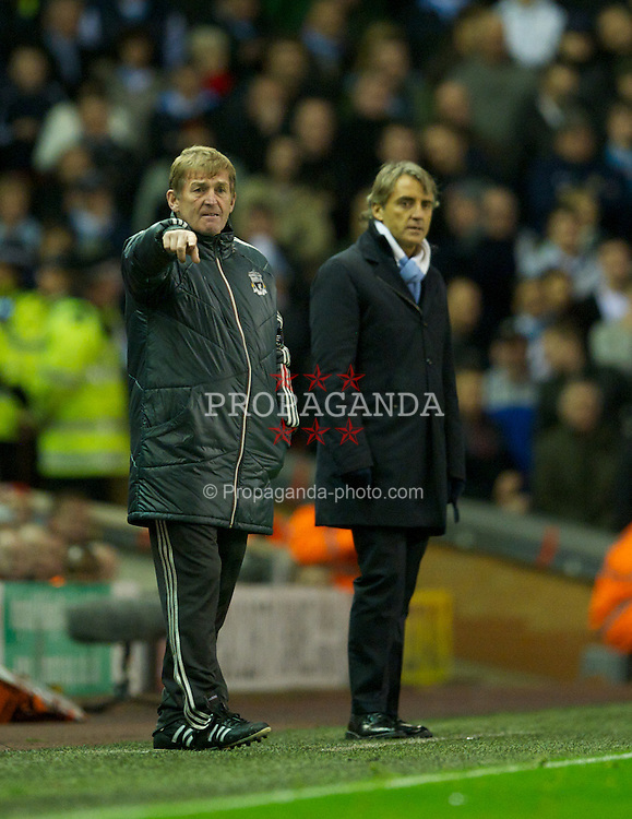 LIVERPOOL, ENGLAND - Sunday, November 27, 2011: Liverpool manager Kenny Dalglish and Manchester City manager Roberto Mancini during the Premiership match at Anfield. (Pic by David Rawcliffe/Propaganda)
