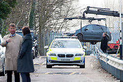 © Licensed to London News Pictures. 24/01/2014. Shenfield,Essex, UK. A car is removed from the scene. Shortly before 6.00am today, 14th January 2014, a 44 year old man was shot in the leg at Shenfield Station, near Brentwood. The assailant fled the scene leaving his car. Photo credit : Simon Ford/LNP