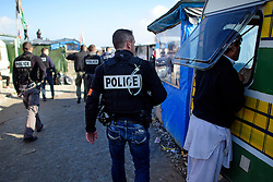 © Licensed to London News Pictures. 25/10/2016. Calais, France.  French police search the migrant and refugee camp in Calais, known as the 'Jungle'. French authorities have moved thousands of refugees and migrants living at the makeshift living area on the French coast, with some still refusing to leave. . Photo credit: Ben Cawthra/LNP