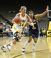 28 NOVEMBER 2007: Iowa forward Johanna Solverson (34) drives to the hoop while being guarded by Georgia Tech guard Jill Ingram (5) in the first half of Georgia Tech's 76-57 win over Iowa in the Big Ten/ACC Challenge at Carver-Hawkeye Arena in Iowa City, Iowa on November 28, 2007.