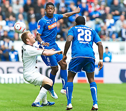 16.04.2011, Rhein-Neckar-Arena, Sinsheim, GER, 1. FBL, TSG 1899 Hoffenheim vs Eintracht Frankfurt, im Bild Patrick Ochs (Frankfurt #2), Edson Braafheid (Hoffenheim #28), David Alaba (Hoffenheim #8), EXPA Pictures © 2011, PhotoCredit: EXPA/ nph/  Roth       ****** out of GER / SWE / CRO  / BEL ******