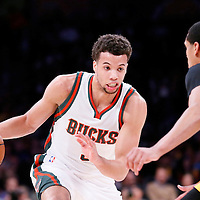27 February 2015: Milwaukee Bucks guard Michael Carter-Williams (5) drives past Los Angeles Lakers guard Jordan Clarkson (6) during the Los Angeles Lakers 101-93 victory over the Milwaukee Bucks, at the Staples Center, Los Angeles, California, USA.