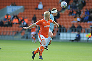 Blackpool Forward, Mark Cullen (9) and Accrington Stanley Midfielder, Scott Brown (8)  during the EFL Sky Bet League 1 match between Blackpool and Accrington Stanley at Bloomfield Road, Blackpool, England on 25 August 2018.