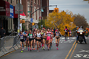 The leading group of female runners is pictured as they approach 4th Ave on 92nd St in the New York City Marathon on 4th Ave in Brooklyn, NY on Sunday, Nov. 3, 2013.<br /> <br /> CREDIT: Andrew Hinderaker for The Wall Street Journal<br /> SLUG: NYSTANDALONE
