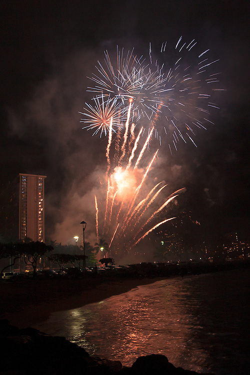 Friday night fireworks explode over the Waikiki skyline in Honolulu, Hawaii