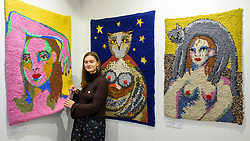 © Licensed to London News Pictures. 05/10/2019. LONDON, UK. Artist Selby with her handmade woven rugs at The Other Art Fair, presented by Saatchi Art.  120 international, independent artists are displaying their works to be sold direct to buyers.  The fair is taking place at Victoria House in Bloomsbury until 6 October 2019.  Photo credit: Stephen Chung/LNP