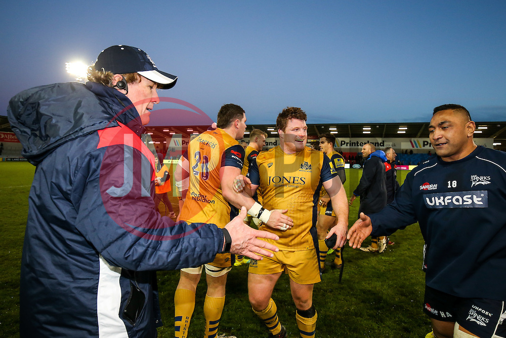 Bristol Rugby Forwards Coach Mark Bakewell is congratulated by Halani Aulika of Sale Sharks and Kyle Traynor of Bristol Rugby is all smiles after Bristol Rugby win 23-24 - Rogan Thomson/JMP - 01/01/2017 - RUGBY UNION - AJ Bell Stadium - Manchester, England - Sale Sharks v Bristol Rugby - Aviva Premiership New Year's Day Fixture.