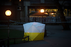 © Licensed to London News Pictures. 06/03/2018. Salisbury, UK. A police tent stands at dusk, covering a park bench  near the Maltings shopping centre in Salisbury where former Russian spy Sergei Skripal and a woman in her 30s were taken ill with suspected poisoning. The couple where found unconscious on bench in Salisbury shopping centre. Specialist units have been called in to deal with any possible contamination. Photo credit: Ben Cawthra/LNP