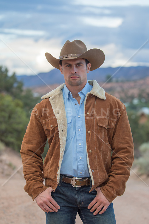 cowboy with green eyes outdoors