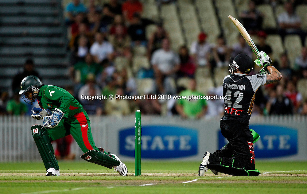 Blackcap batsman Brendon McCullum scoops a ball to the boundary as Bangladeshi keeper Mushfiqur Rahim ducks for cover. KFC Twenty20, New Zealand Blackcaps v Bangladesh, Seddon Park, Hamilton. Wednesday 3rd February 2010. Photo: Simon Watts/PHOTOSPORT