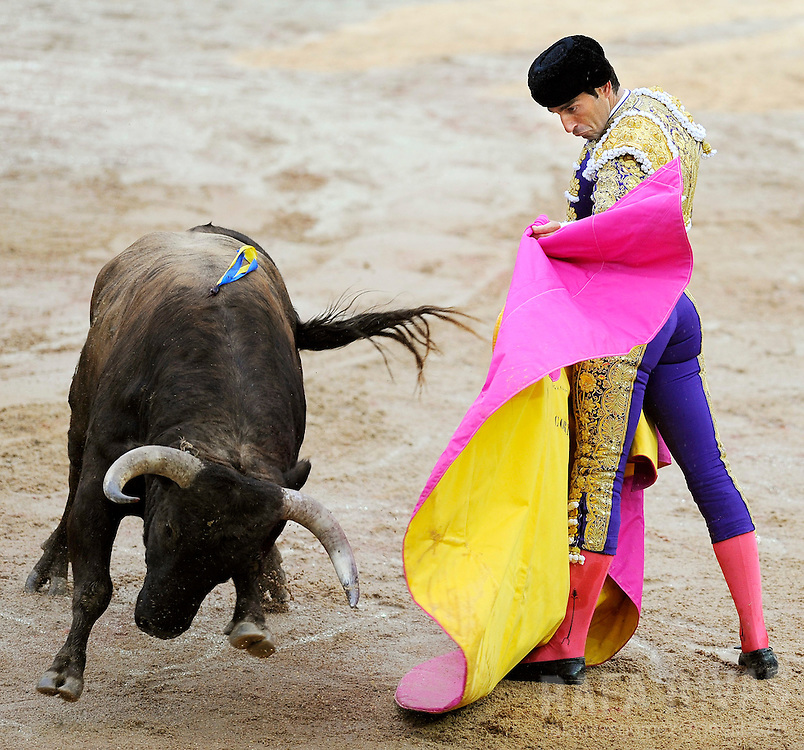Spanish Matador Salvador Cortes fights his fighting bull with capote, on July 12, 2008, during the sixth corrida of the San Fermin festivities, in Pamplona, north of Spain.