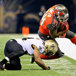 Sep 20, 2015; New Orleans, LA, USA;  New Orleans Saints defensive back Kyle Wilson (24) tackles Tampa Bay Buccaneers running back Charles Sims (34) during the first quarter of a game at the Mercedes-Benz Superdome. Mandatory Credit: Derick E. Hingle-USA TODAY Sports