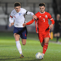 19/3/2019 - Henry Jones(Bala) races clear of Laurence Maguire (Chesterfield) during the C International between England and Wales at the Peninsula Stadium, Salford.<br /> <br /> Pic: Mike Sheridan/County Times<br /> MS023-2019