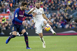 October 28, 2018 - Barcelona, Catalonia, Spain - Karim Benzema vies Gerard Piqué during the spanish league match between FC Barcelona and Real Madrid at Camp Nou Stadium in Barcelona, Catalonia, Spain on October 28, 2018  (Credit Image: © Miquel Llop/NurPhoto via ZUMA Press)