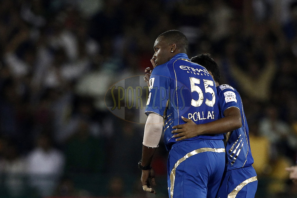 Kieron Pollard of the Mumbai Indians  take the wicket of Yasoda Lanka of the SOUTHERN EXPRESS during the qualifier 4 match of the Oppo Champions League Twenty20 between the Mumbai Indians and the Southern Express held at the Chhattisgarh International Cricket Stadium, Raipur, India on the 14th September 2014<br /> <br /> Photo by:  Deepak Malik / Sportzpics/ CLT20<br /> <br /> <br /> Image use is subject to the terms and conditions as laid out by the BCCI/ CLT20.  The terms and conditions can be downloaded here:<br /> <br /> http://sportzpics.photoshelter.com/gallery/CLT20-Image-Terms-and-Conditions-2014/G0000IfNJn535VPU/C0000QhhKadWcjYs