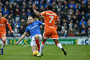Portsmouth Defender, Matt Clarke (5) tackles Blackpool Forward, Nathan Delfouneso (7) during the EFL Sky Bet League 1 match between Portsmouth and Blackpool at Fratton Park, Portsmouth, England on 12 January 2019.