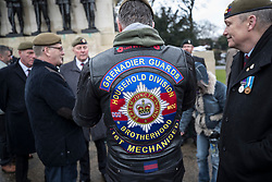 © Licensed to London News Pictures. 03/02/2018. London, UK. A former soldier of the Grenadier Guards wears his regimental badge on a leather jacket during a Veterans for Justice March in central London .Photo credit: Peter Macdiarmid/LNP