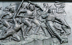 Relief showing historical scene on base of victory Column or Siegessäule in Tiergarten Berlin Germany