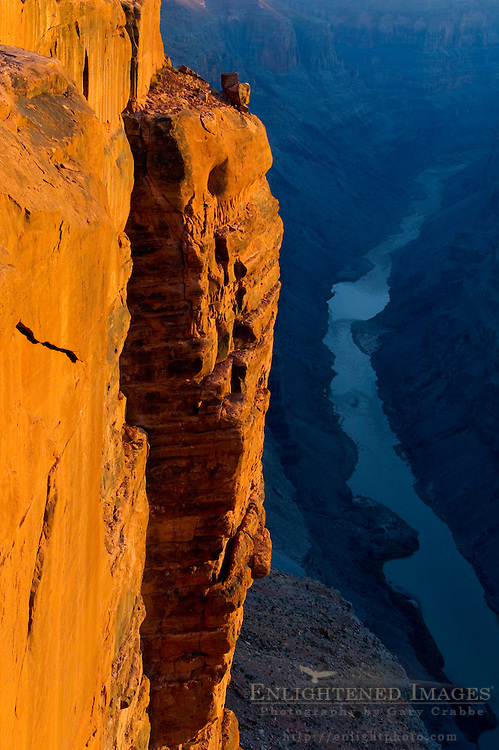 Golden sunrise light on steep sheer rock cliff above the Colorado River, Toroweap, Grand Canyon National Park, Arizona
