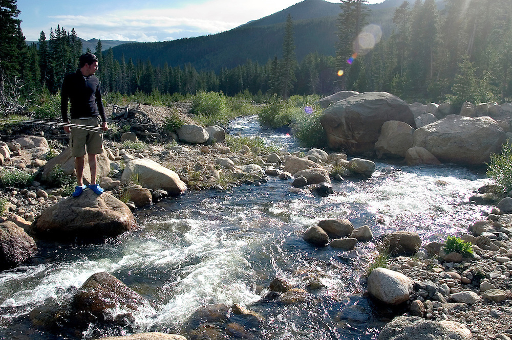 Fly fisherman on a small stream in Colorado