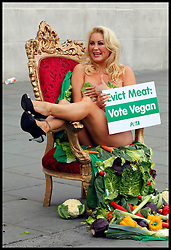 Glamour model Victoria Eisermann, just evicted from Big Brother, sits in a Big Brother diary room chair in Trafalgar Square during a photocall by PETA to highlight their plight against the meat trade, Monday June 25, 2012. Photo By Andre Camara/i-Images