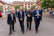 ROME, ITALY - SEPTEMBER 01:  The director of Caritas Rome, Msgr. Enrico Feroci, Italian PM Paolo Gentiloni, New vicar of Rome, Angelo De Donatis, Simone Iannone General Secretary of Caritas of Rome during visit the Citadel of the Charity of the Diocesan Caritas of Rome on September 1, 2017 in Rome, Italy. Italian PM Paolo Gentiloni visited the Caritas to express the gratitude of all Italians to the world of volunteering, to those who work in favour of solidarity.