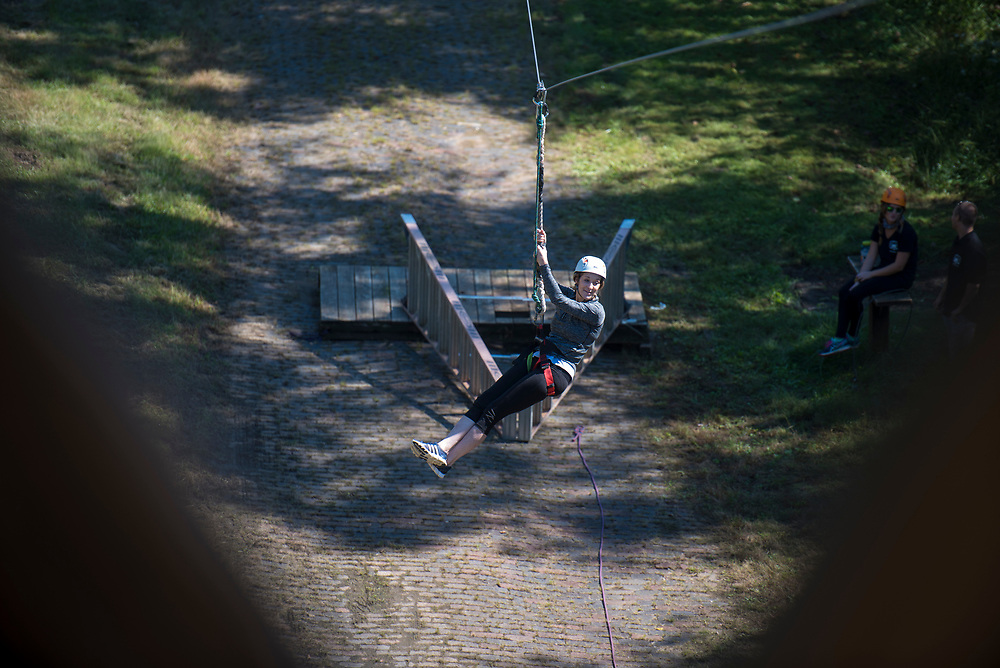 Pamela Gaboury ziplines at the Ohio University Challenge Course at The Ridges. Photo by Hannah Ruhoff