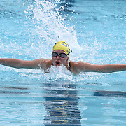 Swimmer Alexandria Boettcher (12) competes in the 100 meter individual medley during the Summer Swim league championships finials Saturday, July. 17, 2015 at Western YMCA in Wilmington, DEL