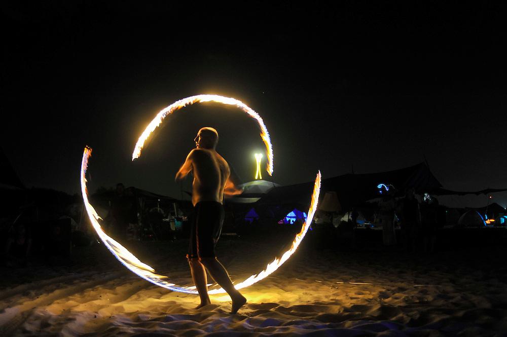 """Fire juggler at """"Mid Burn"""", the Israeli """"Burning Man Festival"""" held at """"Habonim"""" beach north of Israel October 4-6, 2012."""
