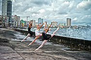 Ballerinas from the National Ballet  of Cuba leaping at El Malecon