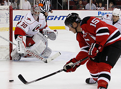 Oct 17, 2009; Newark, NJ, USA; Carolina Hurricanes goalie Cam Ward (30) watches New Jersey Devils right wing Jamie Langenbrunner (15) skate with the puck during the second period at the Prudential Center.