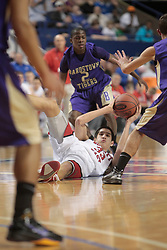Bullitt East's Derek Willis goes after a loose ball in the first quarter. Willis scored 9 points in the first half. Bullitt East hosted Bardstown in 7th game of  the 2011 PNC/ KHSAA Boys Sweet 16, Thursday, March 17, 2011. Photo by Jonathan Palmer