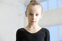 Young girl in dance leotard with hair back
