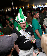'King' Kevin Krumholtz of Washington Township  (center) talks with Mike Gran of Centerville and Hope Caulfield of Kettering during the WTUE St. PatROCKS Party at Flanagan's Pub in Dayton, Saturday, March 17, 2012.