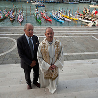 """VENICE, ITALY - SEPTEMBER 02: Monsignor Lucio Ciglia (R) and Piero Rosasalve (L) pose in front of The Gondolini and the """"Regatanti"""" (rowers) after the blessing at Santa Maria della Salute church ahead of Sunday Historic Regata on September 2, 2010 in Venice, Italy. The Historic Regata is the most exciting boat race on the Gran Canal for the locals and one of the most spectacular ***Agreed Fee's Apply To All Image Use***.Marco Secchi /Xianpix. tel +44 (0) 207 1939846. e-mail ms@msecchi.com .www.marcosecchi.com"""