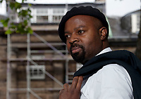 A portrait of Ben Okri at the Edinburgh International Book Festival 2012 in Charlotte Square Gardens<br /> <br /> Pic by Pako Mera