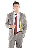 Portrait of handsome tailor standing over white background