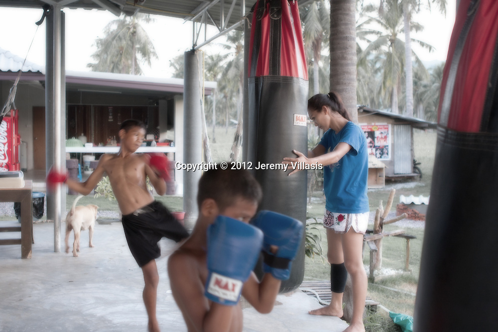 Training the champions of tomorrow. Muay Thai fighters undergo a rigorous training regimen which includes running, pad work, bag work and sparring both in the morning and the afternoon.