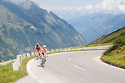 Austria, Tyrol, Hohe Tauern National Park Grossglockner High Alpine Road Cyclist ascend the pass