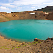 Looking down into the aqua coloured water of the crater lake, surrounded by the tephra (volcanic ash) slopes. Viti Crater, Myvatn, Iceland. July.