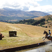 Madeline Dykes riding Me Paleface in action at the water jump during the Cross Country event at the Wakatipu One Day Horse Trials at the Pony Club grounds,  Queenstown, Otago, New Zealand. 15th January 2012. Photo Tim Clayton