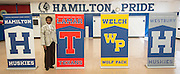 Assistant principal Emma Mosby poses for a photograph next to a Lamar High School banner following the announcement of new mascot names for Lamar, Westbury High School, Welch Middle School and Hamilton Middle Schhool at Hamilton, April 15, 2014.