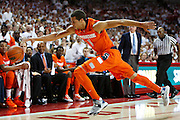 Michael Carter-Williams #1 of the Syracuse Orangemen dives for a ball during a game against the Arkansas Razorbacks at Bud Walton Arena on November 30, 2012 in Fayetteville, Arkansas.  scoke, Save