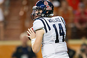 AUSTIN, TX - SEPTEMBER 14: Bo Wallace #14 of the Mississippi Rebels drops back to throw a pass against the Texas Longhorns on September 14, 2013 at Darrell K Royal-Texas Memorial Stadium in Austin, Texas.  (Photo by Cooper Neill/Getty Images) *** Local Caption *** Bo Wallace
