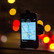 "WASHINGTON, DC - APR 4:  The Uber driver app on the windshield of former Washington Flyer taxi driver Ali Jaghori. Jaghori now drives soley for UberX. Thousands of local car owners have signed up in recent months to drive with one of the ""ride-share"" operators that use smartphone apps to link people needing rides with car owners willing to give them, for a price. (Photo by Evelyn Hockstein/For The Washington Post)"