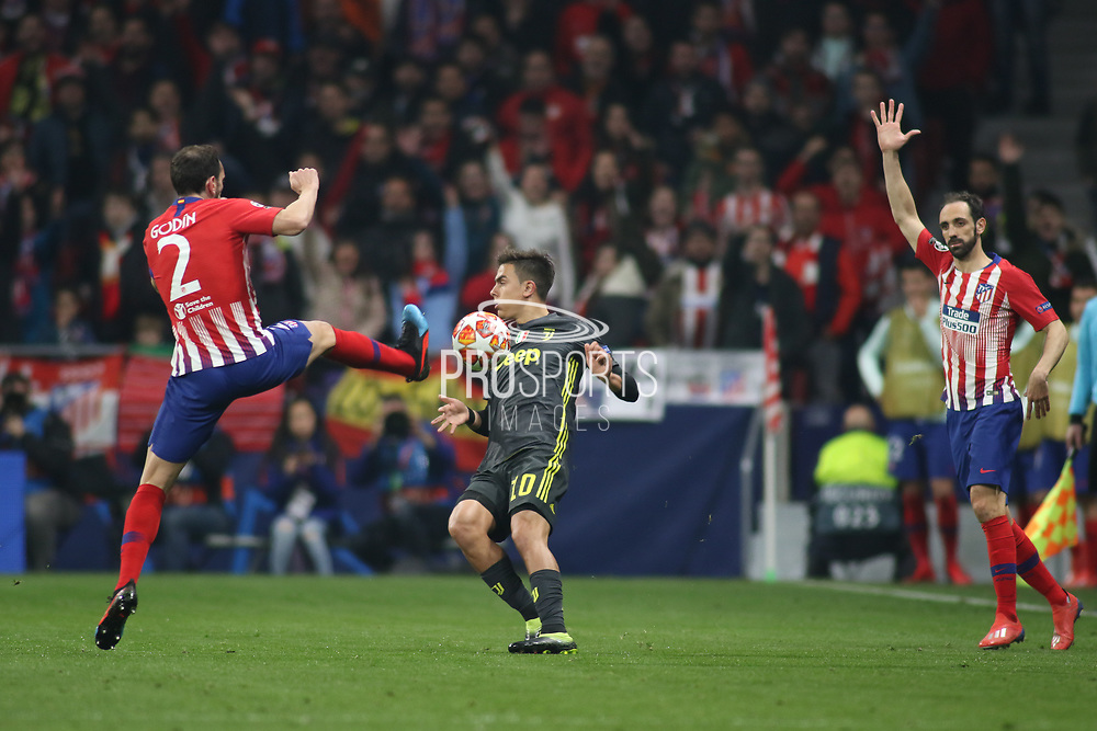 Diego Roberto Godin of Atletico de Madrid and Paulo Dybala of Juventus during the UEFA Champions League, round of 16, 1st leg football match between Atletico de Madrid and Juventus on February 20, 2019 at Wanda metropolitano stadium in Madrid, Spain - Photo Oscar J Barroso / Spain ProSportsImages / DPPI / ProSportsImages / DPPI