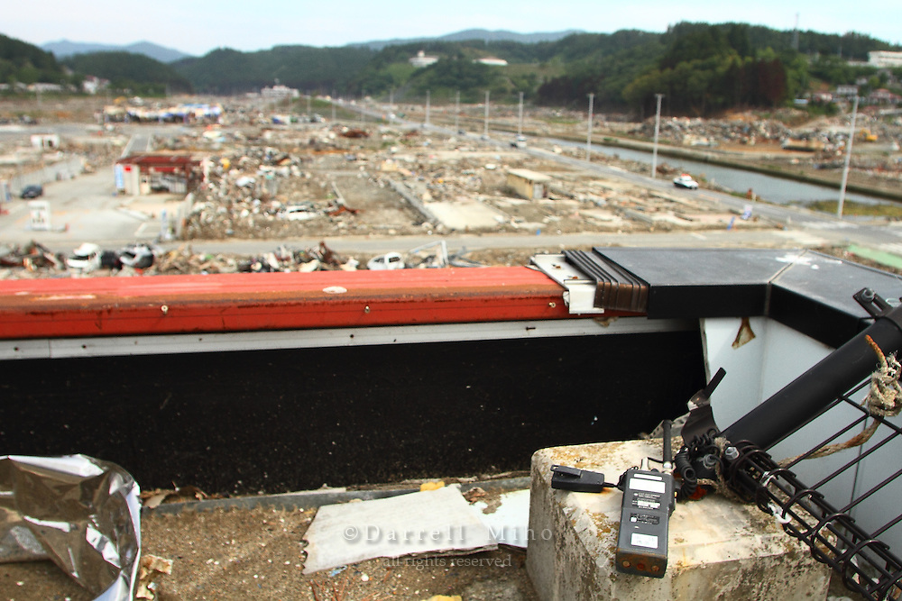 June 12, 2011; Minamisanriku, Miyagi Pref., Japan - A radio sits on the  rooftop of the Crisis Management Department (Bousai Taisaku Chousha) after the magnitude 9.0 Great East Japan Earthquake and Tsunami that devastated the Tohoku region of Japan on March 11, 2011...Miki Endo, a 25 year old employee of the town's Crisis Management Department, was hailed in the Japanese news media as a heroine for continuing to broadcast warnings and alerts over a community loudspeaker system as the tsunami came in. She was credited with saving many lives...In the aftermath of the disaster, Endo was missing and was later confirmed to have died.